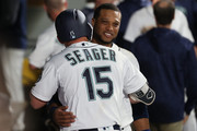 Kyle Seager #15 celebrates with Robinson Cano #22 of the Seattle Mariners after a balk by Dylan Floro #51 of the Los Angeles Dodgers in the tenth inning to win the game 5-4 during their game at Safeco Field on August 18, 2018 in Seattle, Washington.