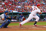 Matt Holliday #7 of the St. Louis Cardinals hits an RBI double in the first inning against the Los Angeles Dodgers at Busch Stadium on July 18, 2014 in St. Louis, Missouri.