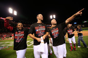 (L-R) Oscar Taveras, Adam Wainwright and Matt Holliday of the St. Louis Cardinals celebrate with teammates after defeating the Los Angeles Dodgers in Game Four of the National League Divison Series at Busch Stadium on October 7, 2014 in St Louis, Missouri.
