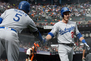 Chase Utley #26 of the Los Angeles Dodgers is congratulated by Corey Seager #5 after Utley score against the San Francisco Giants in the top of the third inning of a Major League Baseball game at AT&T Park on April 7, 2018 in San Francisco, California.