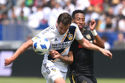 Chris Pontius #19 of Los Angeles Galaxy and Mark-Anthony Kaye #14 of the Los Angeles FC battle for the ball in the second half of the game at StubHub Center on March 31, 2018 in Carson, California.