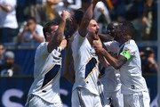 Chris Pontius #19, Perry Kitchen #2, Ema Boateng #24 and Ashley Cole #3 celebrate after a goal by Zlatan Ibrahimovic #9 of Los Angeles Galaxy in the second half of the game against the Los Angeles FC at StubHub Center on March 31, 2018 in Carson, California.