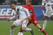Sebastian Lletget #17 of the Los Angeles Galaxy is pressured by Dax McCarty #6 of the Chicago Fire at Toyota Park on April 14, 2018 in Bridgeview, Illinois. The Galaxy defeated the Fire 1-0.