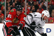 Marian Hossa #81 of the Chicago Blackhawks tries to get off a shot aound Robyn Regehr #44 of the Los Angeles Kings at the United Center on March 30, 2015 in Chicago, Illinois.