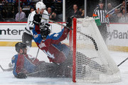 Jan Hejda #8 and Tyson Barrie #4 of the Colorado Avalanche crash into the goal as they defend an empty net against Jeff Carter #77 of the Los Angeles Kings at Pepsi Center on March 10, 2015 in Denver, Colorado.