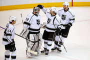Goalie Jonathan Quick #32 of the Los Angeles Kings is congratulated by teammates Justin Williams #14, Drew Doughty #8 and Robyn Regehr #44 of the Los Angeles Kings as they defeated the Colorado Avalanche at Pepsi Center on February 18, 2015 in Denver, Colorado. The Kings defeated the Avlanche 4-1.