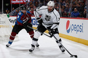 Dwight King #74 of the Los Angeles Kings controls the puck against Jan Hejda #8 of the Colorado Avalanche at Pepsi Center on March 10, 2015 in Denver, Colorado.