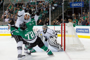 Robyn Regehr #44 of the Los Angeles Kings checks Erik Cole #72 of the Dallas Stars in the third period at American Airlines Center on November 22, 2014 in Dallas, Texas.