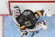 Marc-Andre Fleury #29 of the Vegas Golden Knights blocks a shot by Tyler Toffoli #73 of the Los Angeles Kings as Deryk Engelland #5 of the Golden Knights defends in the first overtime period of Game Two of the Western Conference First Round at T-Mobile Arena on April 13, 2018 in Las Vegas, Nevada. The Golden Knights won 2-1 in double overtime.