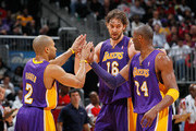 Derek Fisher #2, Pau Gasol #16 and Kobe Bryant #24 of the Los Angeles Lakers react after a timeout during the game against the Atlanta Hawks at Philips Arena on March 8, 2011 in Atlanta, Georgia.  NOTE TO USER: User expressly acknowledges and agrees that, by downloading and/or using this Photograph, user is consenting to the terms and conditions of the Getty Images License Agreement.