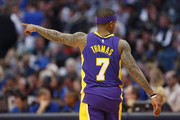 Isaiah Thomas #7 of the Los Angeles Lakers points as the Lakers play the Dallas Mavericks in the second half at American Airlines Center on February 10, 2018 in Dallas, Texas. The Mavericks won 130-123.