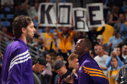 Fans display signs in support of Kobe Bryant (R) #24 of the Los Angeles Lakers as Bryant and Pau Gasol (L) #16 of the Los Angeles Lakers warm up prior to facing the Denver Nuggets in Game Three of the Western Conference Quarterfinals in the 2012 NBA Playoffs at Pepsi Center on May 4, 2012 in Denver, Colorado. The Nuggets defeated the Lakers 99-84 as the Lakers hold a 2-1 advantage in the series. NOTE TO USER: User expressly acknowledges and agrees that, by downloading and or using this photograph, User is consenting to the terms and conditions of the Getty Images License Agreement.