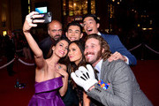 "Actress Genesis Rodriguez (L) takes a selfie with actors (L-R) actors Scott Adsit, Ryan Potter, Jamie Chung, Daniel Henney and T.J. Miller during the Los Angeles Premiere of Walt Disney Animation StudiosÂ' Â""Big Hero 6' at El Capitan Theatre on November 4, 2014 in Hollywood, California."