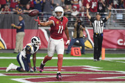Wide receiver Larry Fitzgerald #11 of the Arizona Cardinals reacts after scoring a second quarter touchdown during the NFL game against the Los Angeles Rams at the University of Phoenix Stadium on December 3, 2017 in Glendale, Arizona.