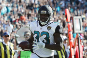 Chris Ivory #33 of the Jacksonville Jaguars runs with the football for a 22-yard touchdown in the first half of their game against the Los Angeles Rams at EverBank Field on October 15, 2017 in Jacksonville, Florida.