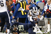 Running back Todd Gurley #30 of the Los Angeles Rams reaches for more yardage as he gets knocked over by free safety Earl Thomas #29 of the Seattle Seahawks during the 3rd quarter of the game at CenturyLink Field on December 17, 2017 in Seattle, Washington.