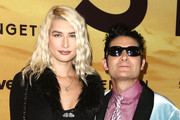 """Courtney Anne Mitchell and Corey Feldman attend the Los Angeles Special Screening Of Discovery's """"Serengeti"""" at Wallis Annenberg Center for the Performing Arts on July 23, 2019 in Beverly Hills, California."""