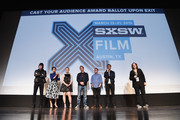 """(L-R) Composer Johnny Jewel, actors Eva Mendes, Saoirse Ronan, Ben Mendelsohn and Iain De Caestecker, director/writer Ryan Gosling, and SXSW Film Festival Director Janet Pierson take part in a Q&A following the """"Lost River""""  premiere during the 2015 SXSW Music, Film + Interactive Festival at Topfer Theatre at ZACH on March 14, 2015 in Austin, Texas."""