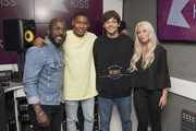 Louis Tomlinson poses with KISS FM Presenters Charlie Hedges (R), Rickie Haywood-Williams (2nd L) and Melvyn Odoom (L) at Kiss FM Studio's on July 19, 2017 in London, England.