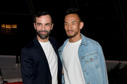 Hidetoshi Nakata and Nicolas Ghesquiere attend the Louis Vuitton Cruise 2020 Fashion Show at JFK Airport on May 08, 2019 in New York City.