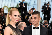 """Professional soccer player Hatem Ben Arfa (R) and guest attend the """"Loving"""" premiere during the 69th annual Cannes Film Festival at the Palais des Festivals on May 16, 2016 in Cannes, France."""