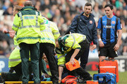Kelvin Etuhu of Barnsley is stretchered off during the FA Cup Fifth Round match between MK Dons and Barnsley at StadiumMK on February 16, 2013 in Milton Keynes, England.