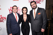 (L-R) Mike Bruno, Demi Lovato and Tony Gervino attend the Billboard Women in Music Luncheon on December 11, 2015 in New York City.