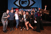 (L-R front) Singer/songwriter Shawn Mendes, guest, rappers Hoodie Allen and Jake Miuller, singer Beatrice Miller, musician Sydney Sierota of Echosmith, guest, singer Jacquie Lee, singer Ryn Weaver, and (L-R behind) musicians Etienne Bowler, Marc Campbell, William Hehir, Mandy Lee, and Dr. Blum of MisterWives pose onstage during the MTV Artists to Watch at House of Blues Sunset Strip on February 5, 2015 in West Hollywood, California.