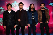 (L-R) Matthew Followill, Jared Followill, Nathan Followill and Caleb Followill of Kings of Leon attend the MTV EMA's 2013 at the Ziggo Dome on November 10, 2013 in Amsterdam, Netherlands.
