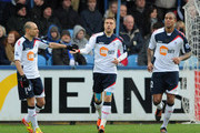 Ivan Klasnic of Bolton celebrates scoring their first goal with Martin Petrov (L) and  Zat Knight of Bolton (R) during the Budweiser sponsored FA Cup third round match between Macclesfield Town and Bolton Wanderers at Moss Rose Ground on January 7, 2012 in Macclesfield, England.