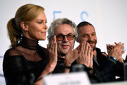 Charlize Theron and Tom Hardy Photos Photo