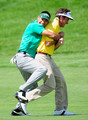 Alvaro Quiros holds onto playing partner and country man Gonzalo Fernandez - Castano of Spain during the second round of the Madrid Masters at Real Sociedad Hipica Espanola Club De Campo on May 28, 2010 in Madrid, Spain.