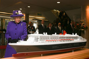Queen Elizabeth II looks at a model of the RMS Queen Mary 2 transatlantic ocean liner during a visit to the International Maritime Organization (IMO) to mark the 70th anniversary of its formation on March 6, 2018 in London, England.