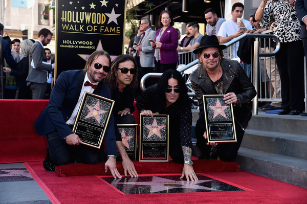 Mana Honored With Star On The Hollywood Walk Of Fame [mana honored with star on the hollywood walk of fame,carpet,red carpet,flooring,event,premiere,games,fher olvera,juan calleros,alex gonzalez,sergio vallin,rock band,man\u00e3,hollywood walk of fame,mexican,ceremony]