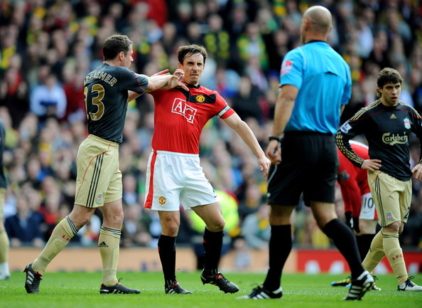 Gary Neville Jamie Carragher (L) of Liverpool argues with Gary Neville of