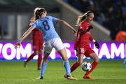 Kosovare Asllani of Linkoping beats Jill Scott of Manchester City Women during the UEFA Women's Champions League quarter final, first leg match between Manchester City Women and Linkoping at The Academy Stadium on March 21, 2018 in Manchester, England.