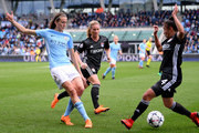 Jill Scott of Manchester City Women and Selma Bacha of Lyon compete for the ball during the UEFA Women's Champions League Semi Final, first leg match between Manchester City Women and Lyon at The Academy Stadium on April 22, 2018 in Manchester, England.