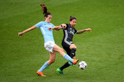 Jill Scott of Manchester City Women and Dzsenifer Marozsan of Lyon compete for the ball during the UEFA Women's Champions League Semi Final, first leg match between Manchester City Women and Lyon at The Academy Stadium on April 22, 2018 in Manchester, England.