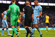 Vincent Kompany of Manchester City (4) appeals to referee Mike Dean as he concedes a penalty during the Barclays Premier League match between Manchester City and Arsenal at Etihad Stadium on January 18, 2015 in Manchester, England.