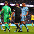 Mike Dean Photos - Vincent Kompany of Manchester City (4) appeals to referee Mike Dean as he concedes a penalty during the Barclays Premier League match between Manchester City and Arsenal at Etihad Stadium on January 18, 2015 in Manchester, England. - Manchester City v Arsenal - Premier League