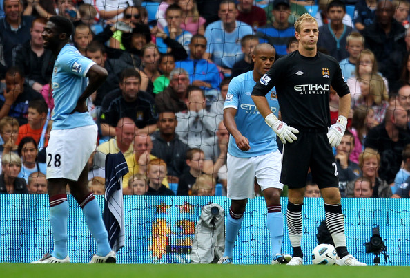 Joe Hart and Kolo Toure (L) of Manchester City look dejected after Nikola Kalinic of Blackburn Rovers scored the opening goal during the Barclays Premier League match between Manchester City and Blackburn Rovers at the City of Manchester Stadium on September 11, 2010 in Manchester, England.