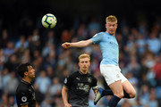 Kevin De Bruyne of Manchester City controls the ball as Jack Cork of Burnley looks on during the Premier League match between Manchester City and Burnley FC at Etihad Stadium on October 20, 2018 in Manchester, United Kingdom.