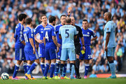 .Referee Mike Dean shows a red card to Pablo Zabaleta of Manchester City during the Barclays Premier League match between Manchester City and Chelsea at the Etihad Stadium on September 21, 2014 in Manchester, England.