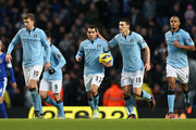 Carlos Tevez Gareth Barry Photos Photo