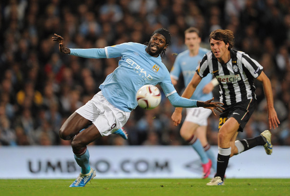 Emmanuel Adebayor of Manchester City tries to get to a cross ahead of Paulo De Ceglie of Juventus during the UEFA Europa League Group A match between Manchester City and Juventus FC at the City of Manchester Stadium on September 30, 2010 in Manchester, England.