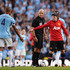 Wayne Rooney of Manchester United shakes hands with Vincent Kompany of Manchester City as referee Howard Webb looks on during the Barclays Premier League match between Manchester City and Manchester United at the Etihad Stadium on September 22, 2013 in Manchester, England.