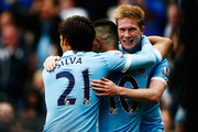 Sergio Aguero (C) of Manchester City celebrates scoring his fourth and team's fifth goal with David Silva (L) and Kevin de Bruyne (R) during the Barclays Premier League match between Manchester City and Newcastle United at Etihad Stadium on October 3, 2015 in Manchester, United Kingdom.