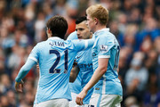 Sergio Aguero (C) of Manchester City celebrates scroring his second goal with team mates during the Barclays Premier League match between Manchester City and Newcastle United at Etihad Stadium on October 3, 2015 in Manchester, United Kingdom.