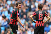 Captain Joey Barton of QPR remonstrates with teammate Suk-Young Yun of QPR during the Barclays Premier League match between Manchester City and Queens Park Rangers at the Etihad Stadium on May 10, 2015 in Manchester, England.