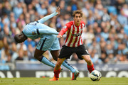 Filip Djuricic of Southampton and Yaya Toure of Manchester City compete for the ball during the Barclays Premier League match between Manchester City and Southampton at Etihad Stadium on May 24, 2015 in Manchester, England.